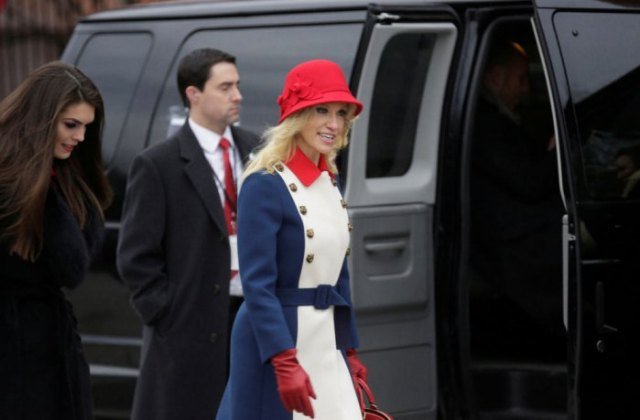red bush hat with white and blue belted coat dress