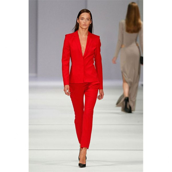 red suite with black heels and no blouse