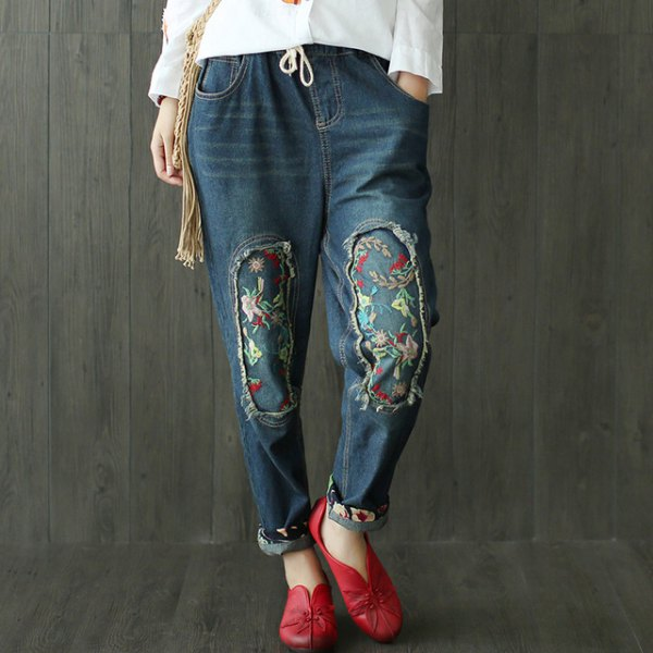 white blouse with dark blue embroidered fleece lined jeans