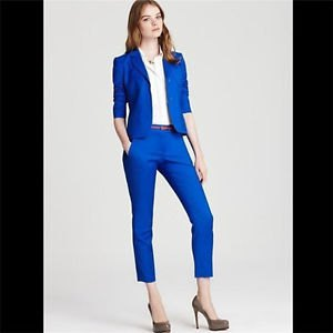 white button up shirt with blue slim fit suit and pink heels