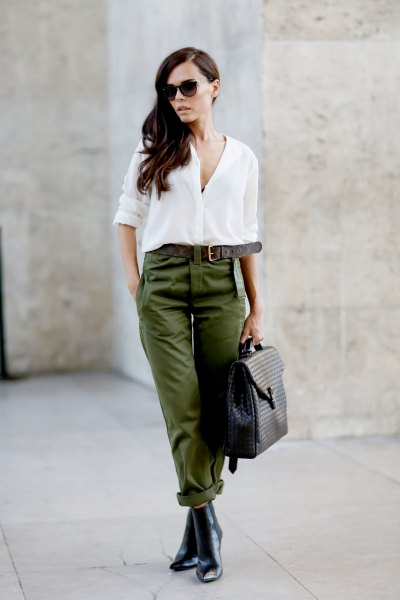 white chiffon button up blouse with green belted pants and leather chelsea boots