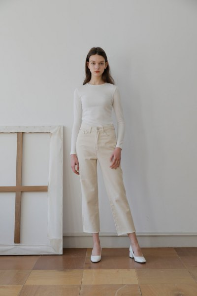 white form fitting long sleeve tee with ivory cropped jeans