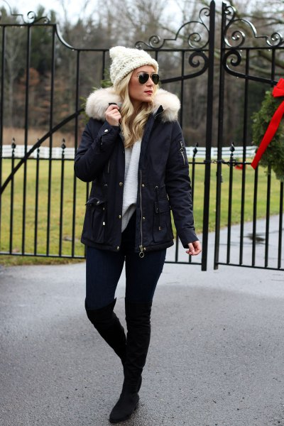 white knit coat with faux fur jacket and knee high boots