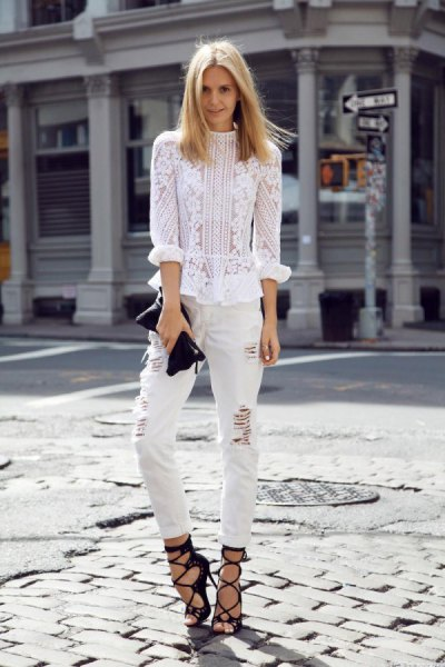white lace blouse with ripped slim fit jeans and strappy heels