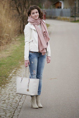 white leather blazer with blue cuffed jeans and pink heeled boots