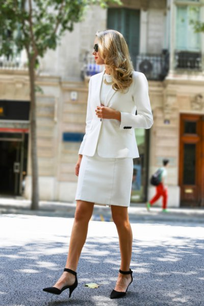 white skirt suit with black pointed toe suede ankle strap heels