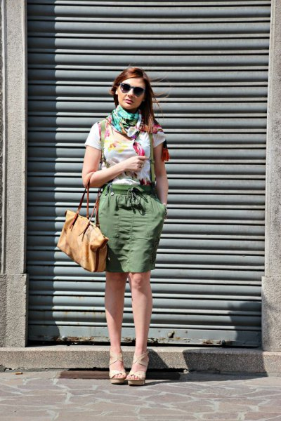 white t shirt with grey scarf and green knee length cargo skirt