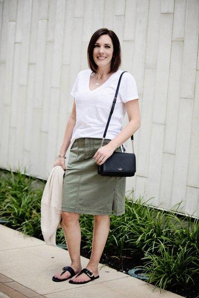 white v neck t shirt with grey knee length straight cut skirt