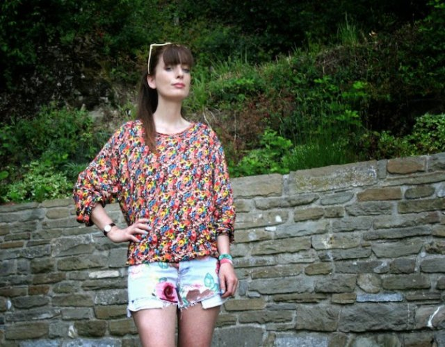 yellow and blue floral printed blouse with mini graphic designer shorts