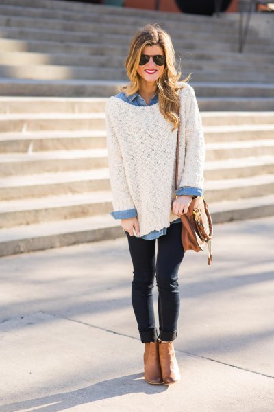 big white sweater with light blue chambray shirt