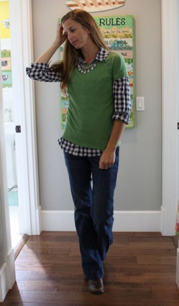 black and white checkered shirt with green short sleeve sweater