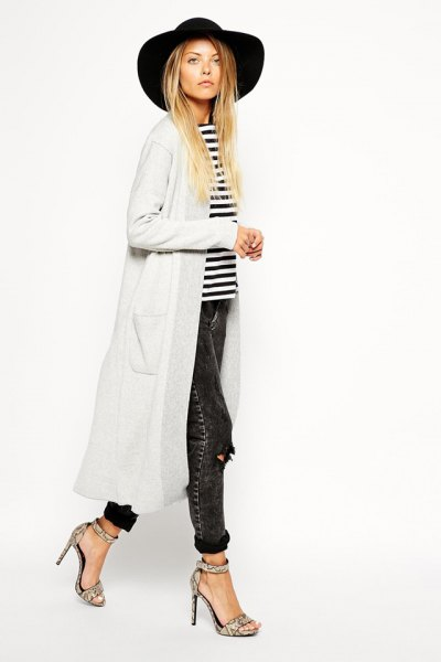 black floppy hat with white maxi cardigan and striped tee