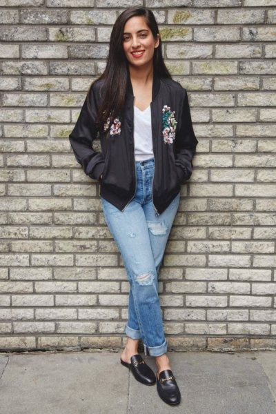 black floral bomber jacket with white v neck tee and loafers
