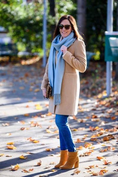 blush pink long wool coat with sky blue fringe scarf