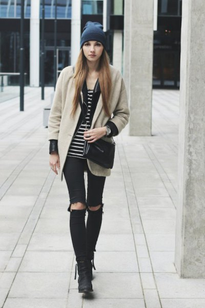 blush pink wool coat with black and white striped tank top and ripped knee jeans