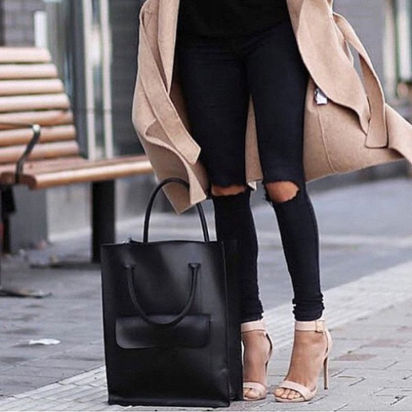 blush pink wool coat with black ripped knee jeans