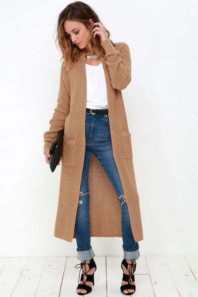 brown maxi sweater cardigan with blue high rise cuffed jeans