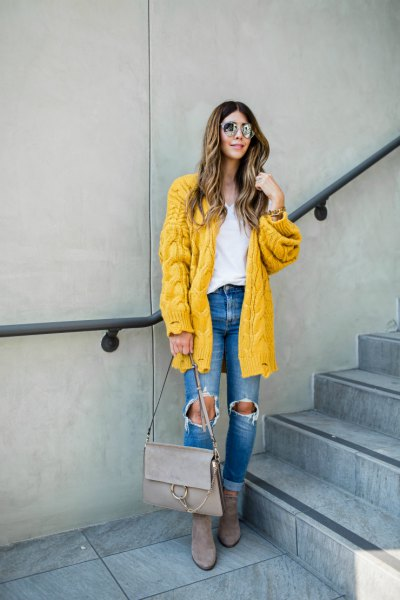 cable knit lemon yellow sweater cardigan with blue destroyed jeans