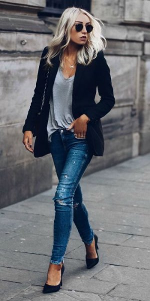 dark blue blazer with grey v neck t shirt and ripped jeans