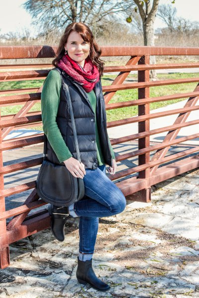 green cowl neck sweater with black quilted vest