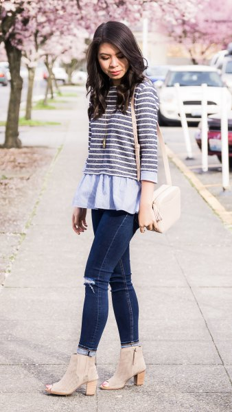 grey and white striped top over light blue peplum blouse