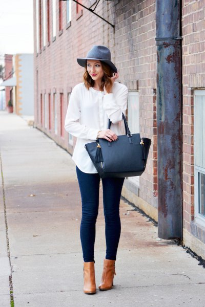 grey floppy hat with white linen boyfriend shirt and blue skinny jeans