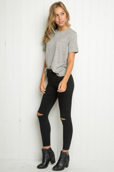 grey oversized tee with black high rise skinny ripped jeans