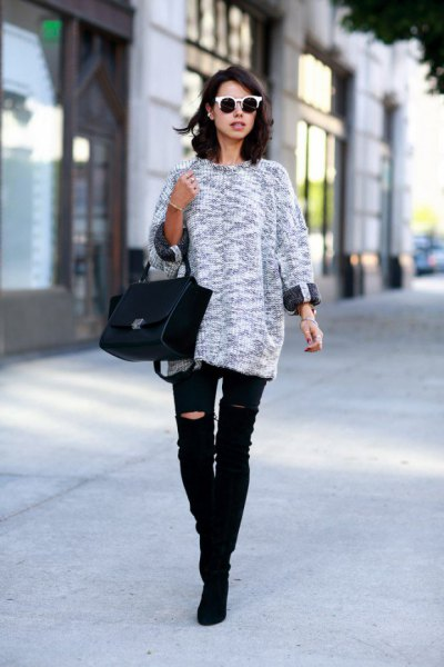 heather grey knit sweater with black ripped knee jeans