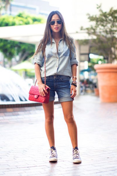 light blue button up shirt with cuffed denim shorts