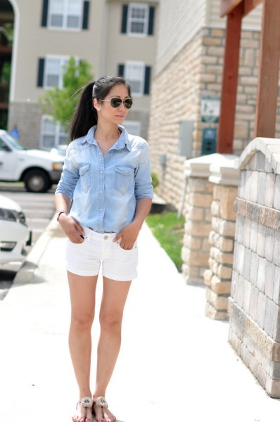 light blue chambray button up shirt with white jean shorts
