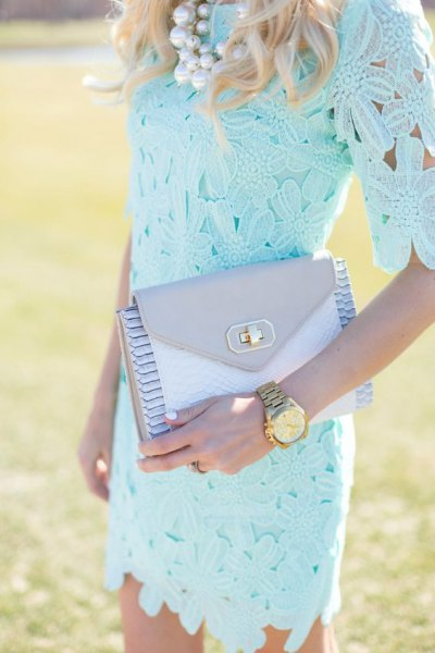light blue lace half sleeve lace bodycon dress with matching clutch bag