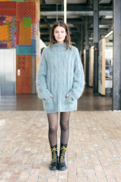 mock neck big cable knit sweater dress with stockings and long boots