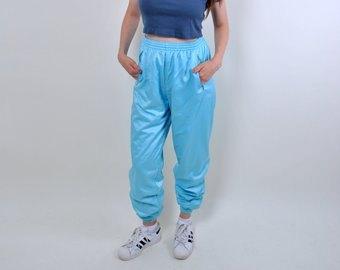 navy crop top with sky blue windbreaker pants
