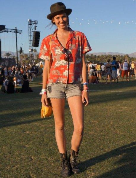 orange and white floral printed aloha shirt with light blue denim shorts
