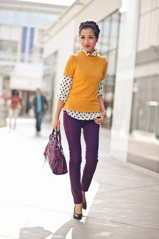 orange short sleeve sweater with white and black polka dot shirt