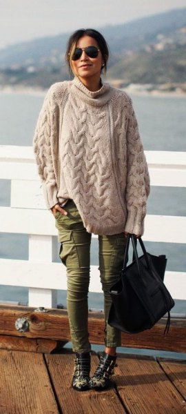 pale pink cable knit oversized sweater with green skinny cargo jeans