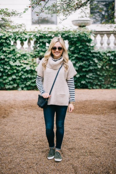 pale pink short sleeve sweater with black and white striped tee