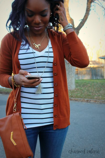 red cardigan sweater with white and black striped v neck top
