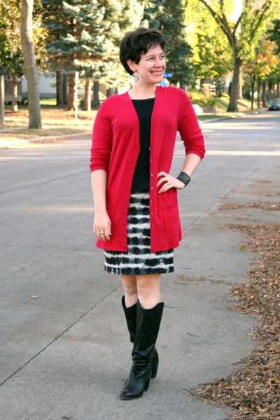 red long sweater cardigan with black and white printed mini skirt