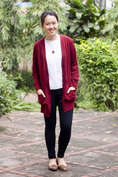 red longline cardigan sweater with white and black polka dot top