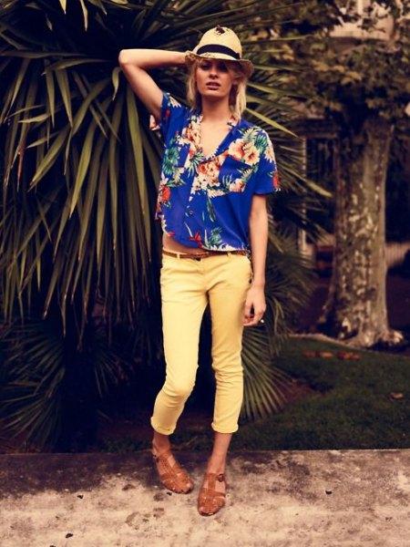 royal blue aloha shirt with straw hat and yellow pants