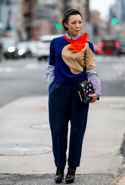 royal blue sweater with striped round collar shirt and black pants