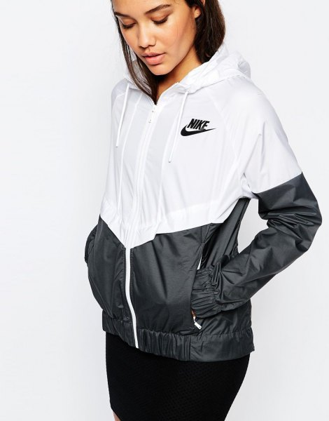 white and black color block windbreaker with skinny jeans