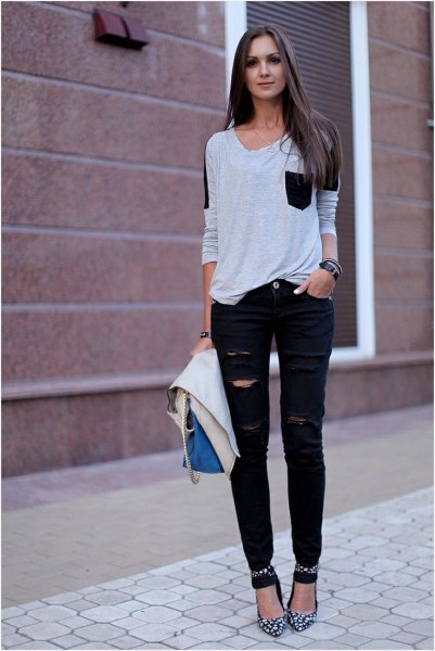 white and black front pocket tee with ripped jeans and ankle strap heels