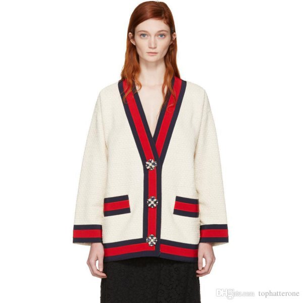 white and red cardigan sweater with black midi skirt