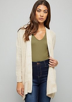 white cardigan with green v neck tee and high waisted blue jeans
