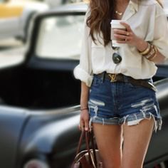 white relaxed fit linen button up shirt with ripped blue denim shorts