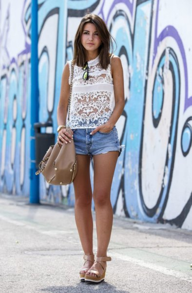 white sleeveless lace blouse with mini denim shorts and heeled sandals