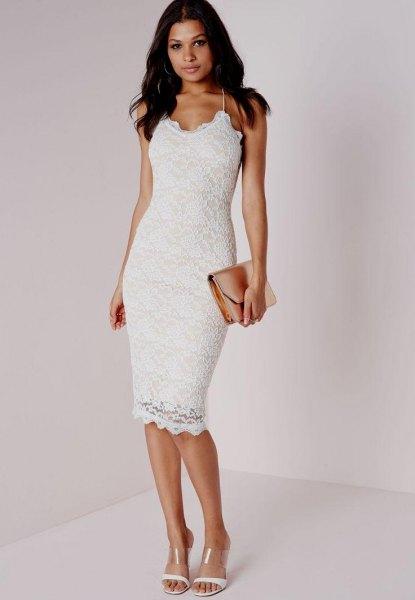 white spaghetti strap bodycon scalloped hem dress with clutch bag