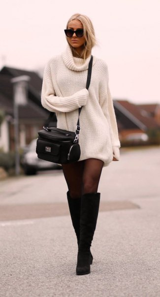 white sweater dress with stockings and knee high black boots